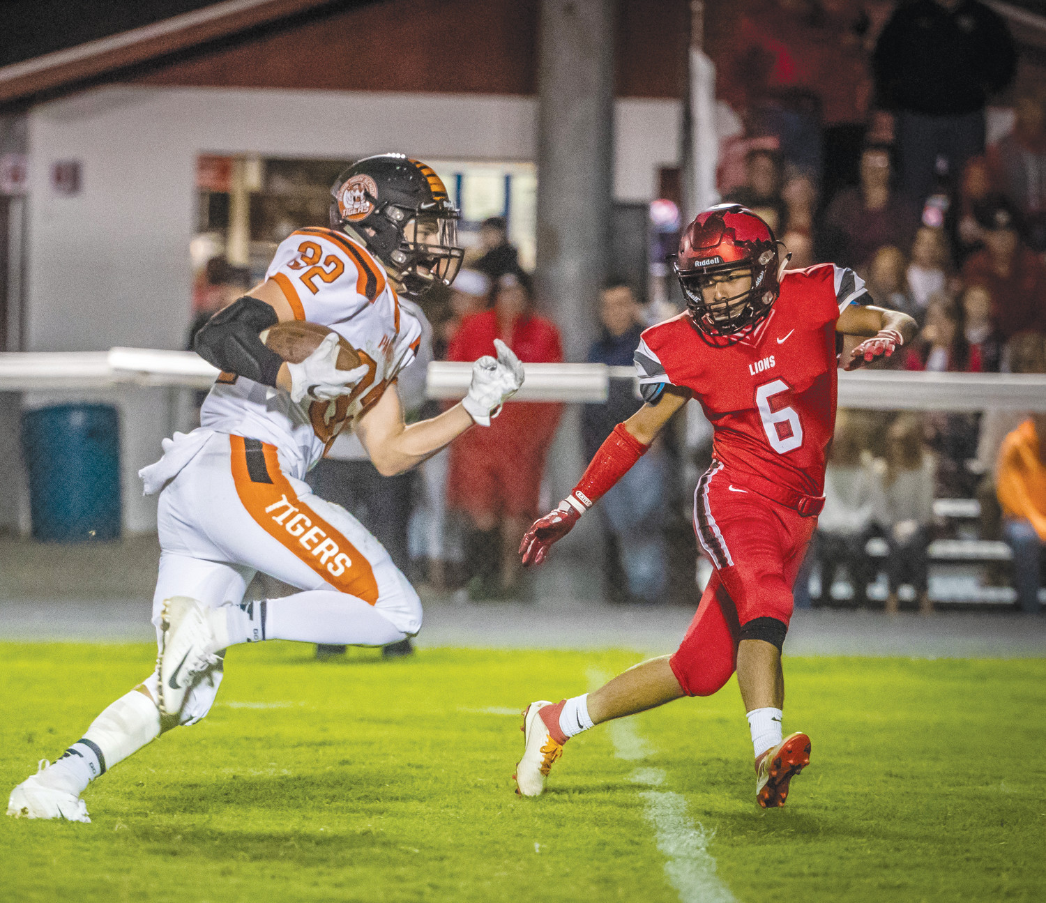 Tiger senior wide receiver Josh Willmoth (32) as Marshall defender Francisco Nava tries to get in position to tackle him. Paris spoiled the Lion homecoming with a 49-14 win Friday.