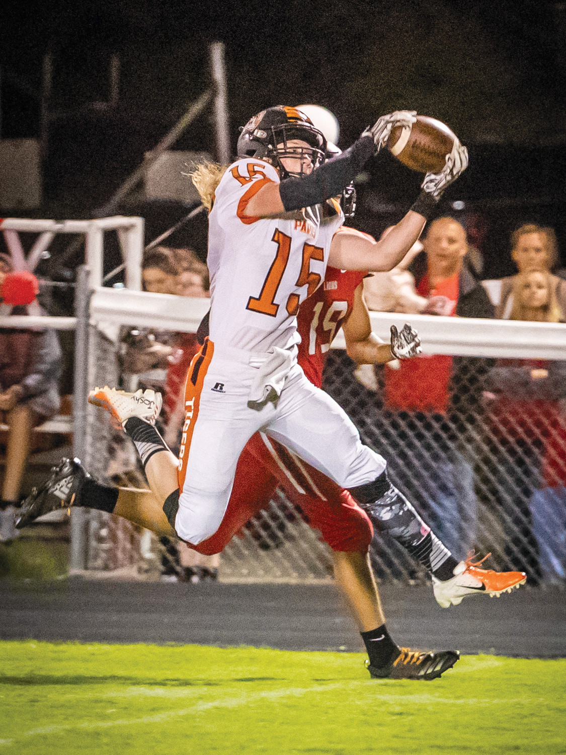 Tiger wide receiver Caleb Mullenix  outruns a defender and hauls in a pass from quarterback Caleb Gates in the Tigers big win over Marshall Friday.
