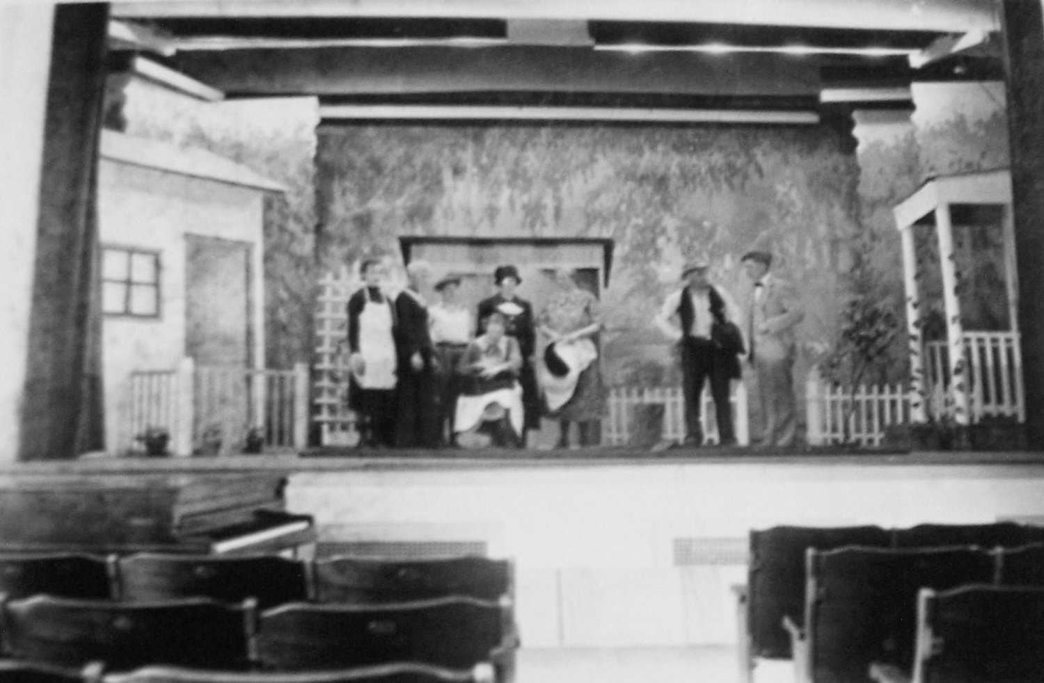 "The stage setting for ""Uncle Jimmy"" taken at the Paris High School auditorium in November 1934 The people on stage in no certain order are Pauline Thompson, Mrs. James Bolin, Mrs. Walter Morris, Emmajean Means, Lois Ann Morris, Mrs. Archie Morris, John Stanley and Walter Kimble representing the Pine Grove Community Club. (Special to The Prairie Press)"