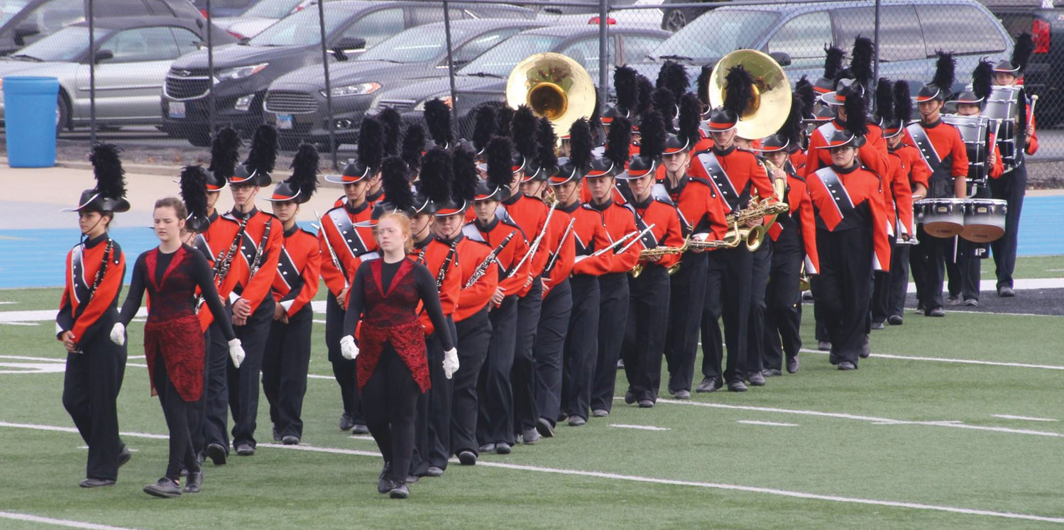 The Paris High School Beacon Brigade marches onto the field at Eastern Illinois University this past September to compete in the annual EIU marching band contest. The brigade is composed of PHS students but is not a requirement to participate in the high school band program.