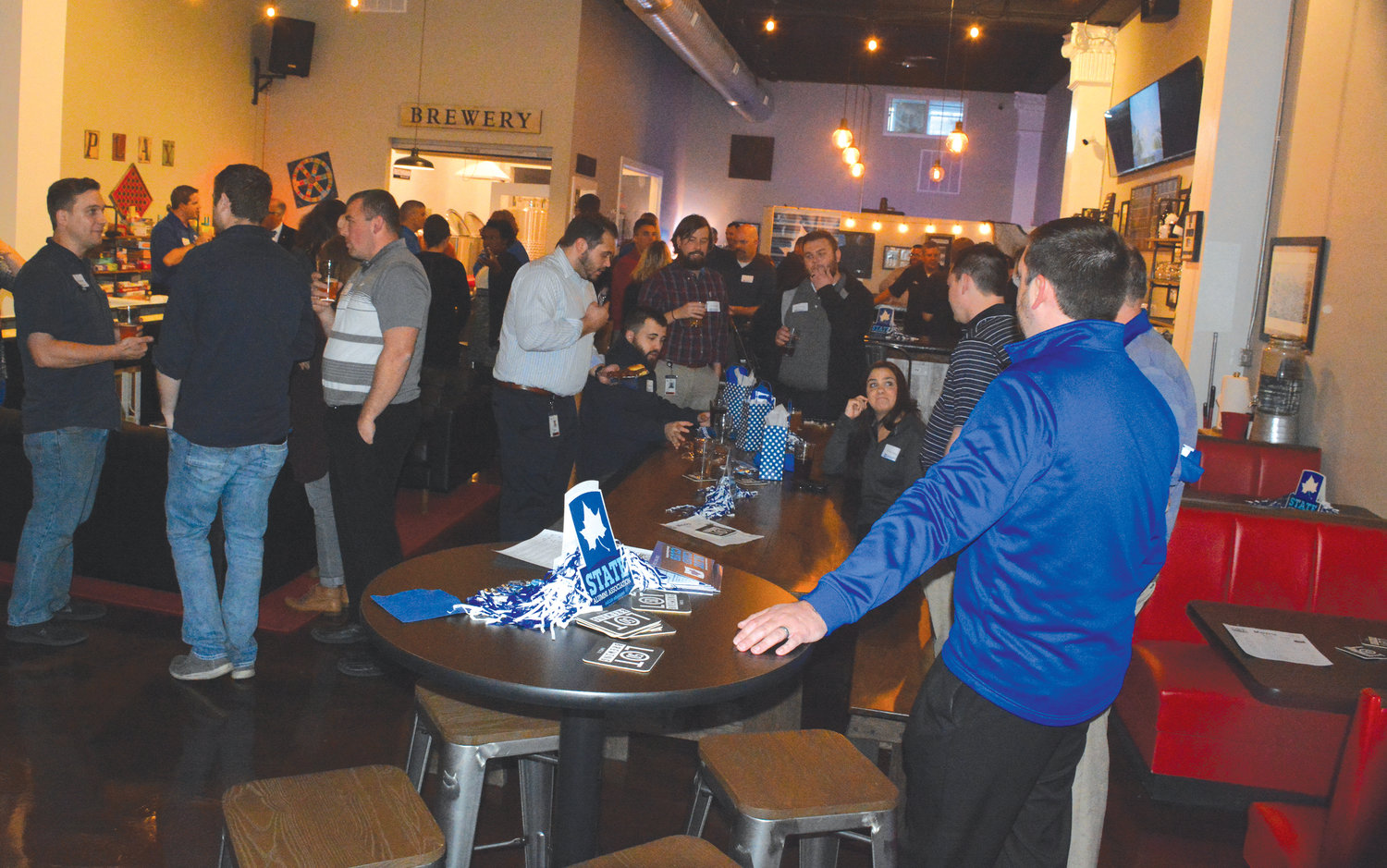 Representatives of Indiana State University and NAL enjoy a social at Lot 50 after the university and the company inked the first formal corporate partnership earlier this week.