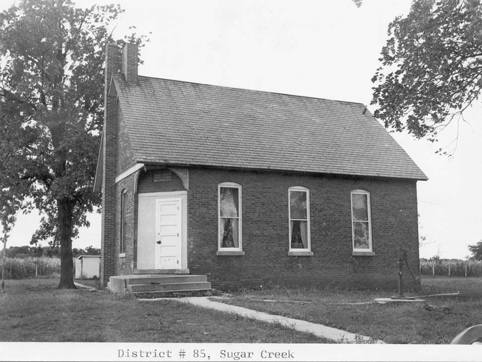 Sugar Creek Point School started as a one-room, rural school. It was later converted into a private home on 1200th Road.