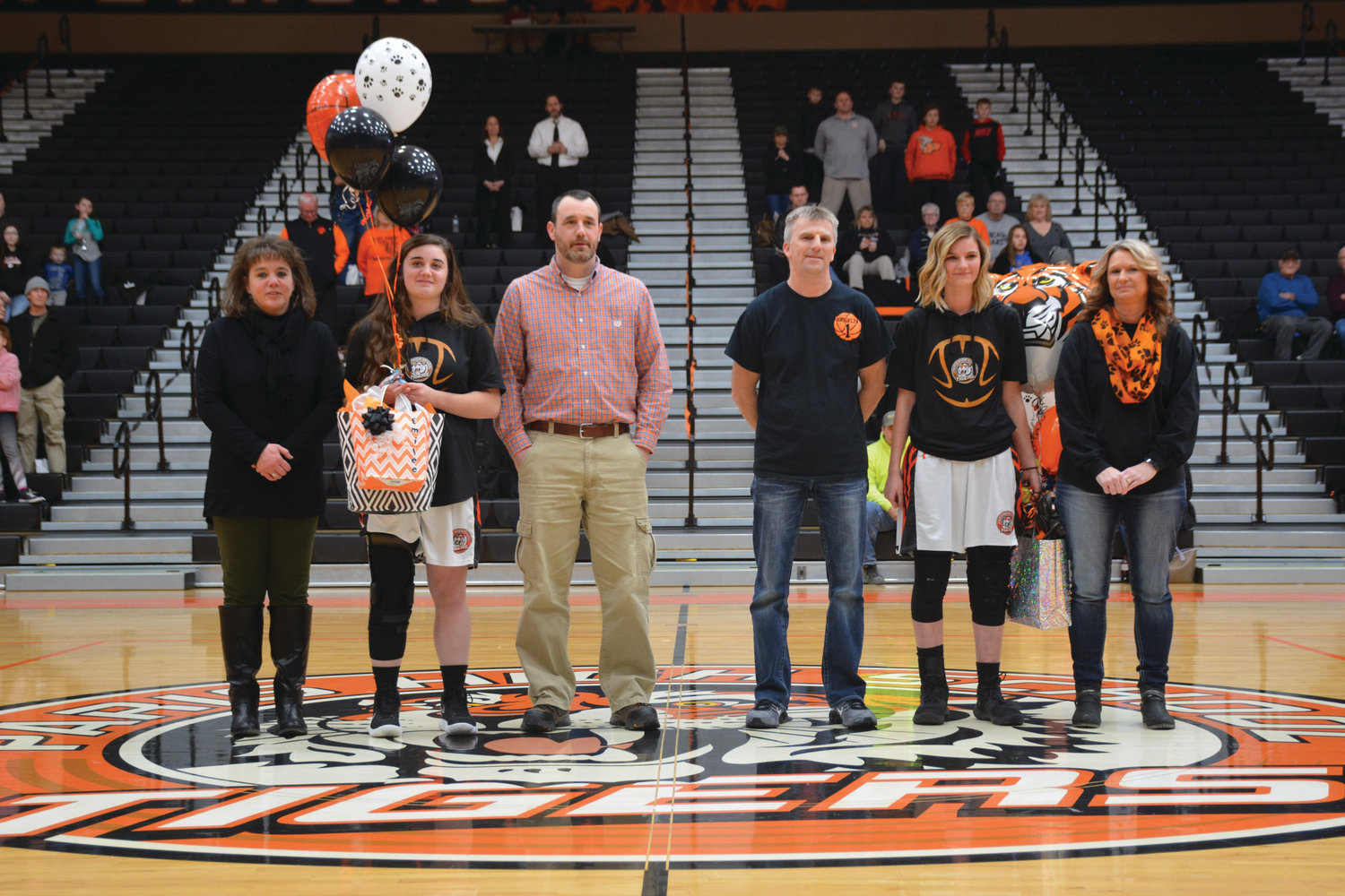Prior to the start of the Varsity contest between the Paris Lady Tigers and conference opponent the Flora Lady Wolves, the two Seniors on the Lady Tigers roster were recognized along with their parents.  Left to right, Lisa Roush, Emilee Roush, Jeff Roush, Mike Westerfield, Brooklyn Westerfield and Tonya Westerfield.