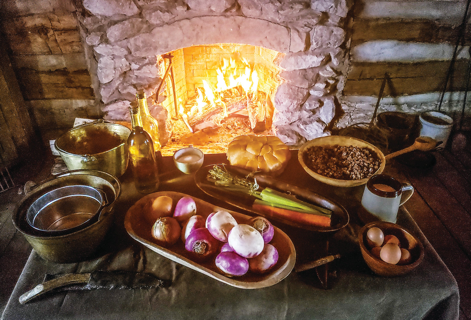 With the fireplace roaring in the Eslinger Cabin and a fire pit outside, it is time to begin the prep work for a bountiful meal. The turnips, carrots and celery pictured are common ingredients for colonial era cooking.
