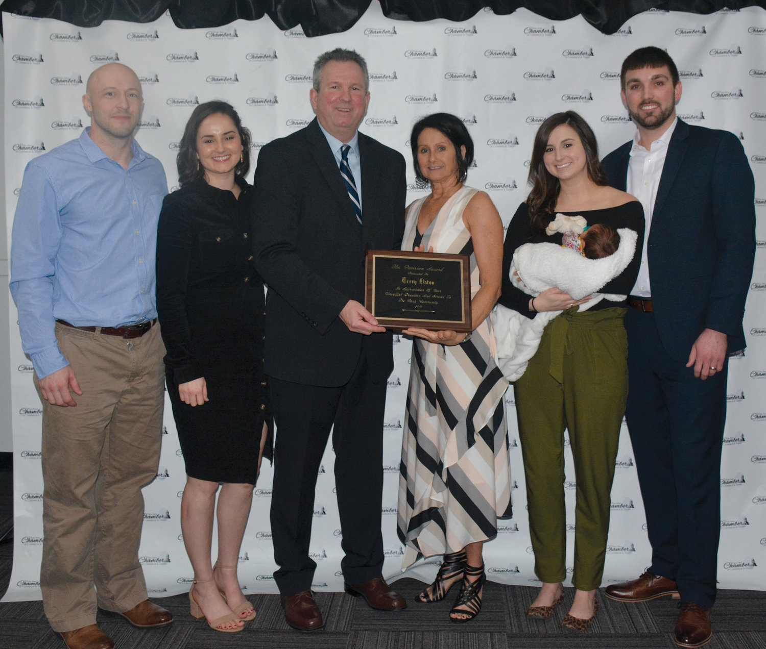 The family of 2019 Parisian Award recipient Terry Elston were present for the celebration Saturday, March 23, at the Tingley Reception Center. Pictured, from left are daughter and son-in-law Elliott and Kristin Booe, Elston and his wife, Melodie and daughter Kaitlin Temples holding her daughter, Greysen with husband Dalten Temples. Elston was honored for his work not only with PEDCO and the ECCEL Academy but his support of all things youth and Paris.