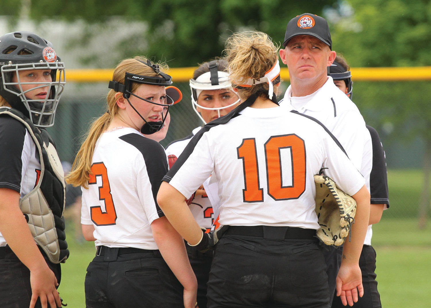 Paris softball head coach Jeremy Clodfelder meets with pitcher Karley Moore (3) and other members of the team in the pitching circle in an IHSA Class 3A regional championship game at Wabash Park in Rantoul on Saturday morning, May 25. Paris fell to the Mt. Zion Lady Braves 4-0 to finish 2019 season 28-3 overall, a school-record for single-season wins.