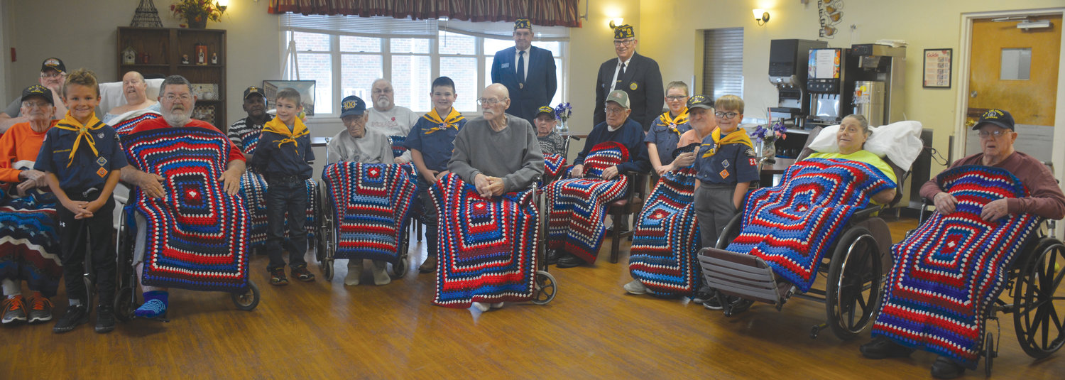 During a ceremony conducted by the Paris American Legion, 13 veterans who reside at Paris Healthcare were presented hand crocheted lap robes, made by Linda Macy-Jones of Kansas. Kansas Cub Scouts presented reach of the robes to the veterans during the ceremony, arranged by past Paris American Legion Commander Terry Hackett and current Paris Commander Paul Hanks.