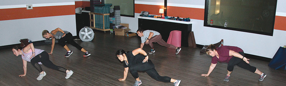 Members of a fitness class at the THE REC in Paris run through exercises. The first of a new year brings plans of doing better with diet and fitness as many make resolutions and then flood the gyms to work out. Planning and preparing for a change in lifestyle is a key to being successful in the long run.