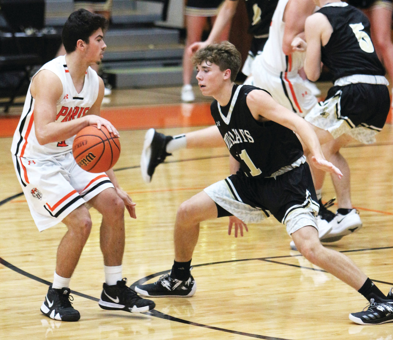 Mason Hutchings, left, works the ball away from a South Vermillion player during the Jan. 7 game at Paris High School.