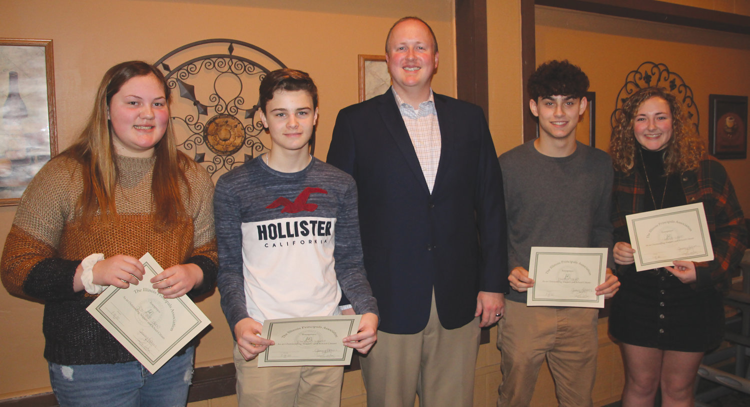 Chrisman students were among those honored at the Edgar County Principal's Breakfast Friday, Jan. 10, at Tuscany Restaurant in Paris. Pictured, from left, are Peyton Gore, Triston Lehmkuhl, Chrisman Junior and Senior High School Principal Cole Huber, Phillip Warner and Alexis Lewsader.