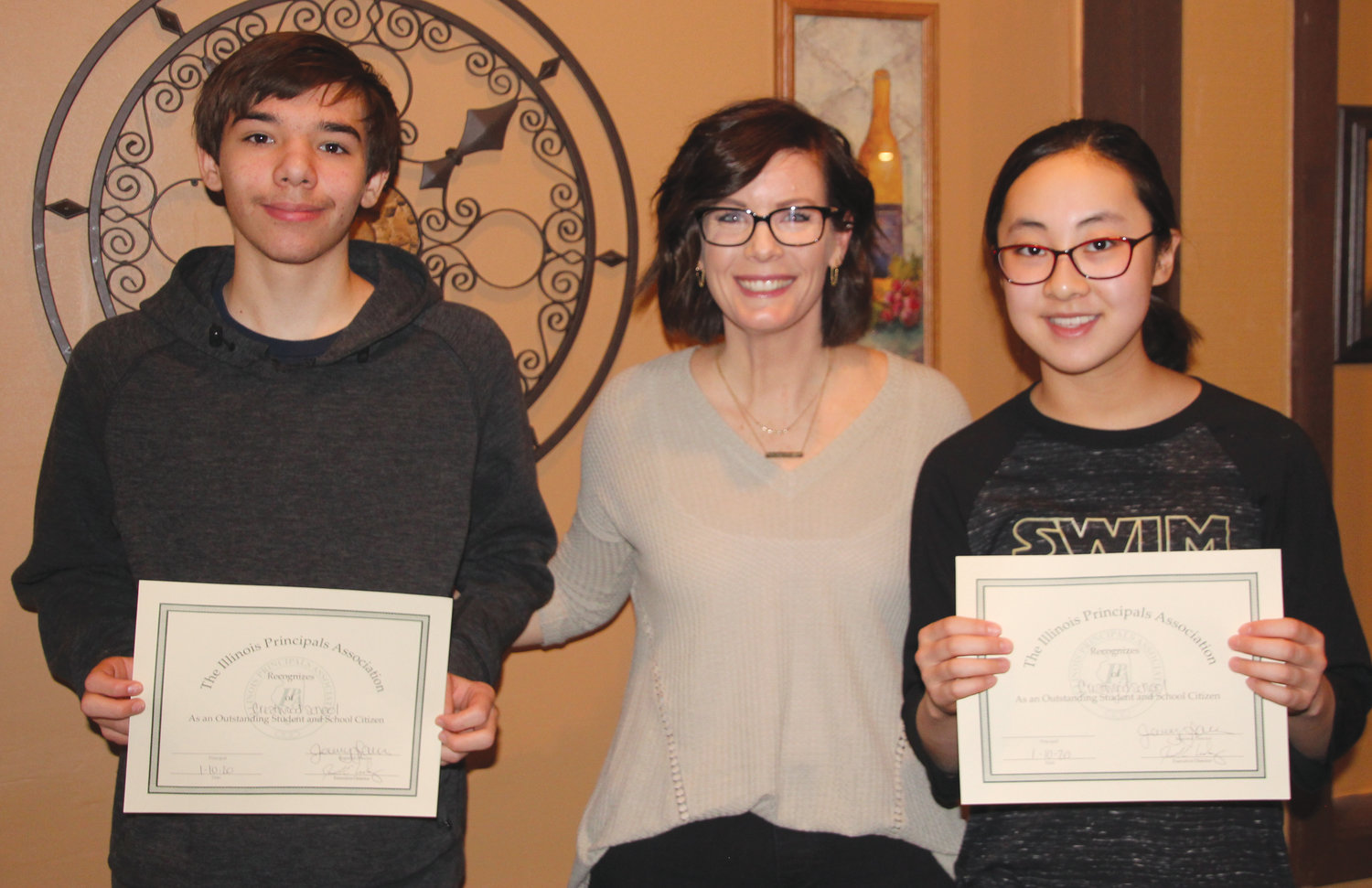 Two Crestwood students were honored at the Edgar County Principal's Breakfast Friday, Jan. 10, at Tuscany Restaurant in Paris. Pictured, from left, are Wayde Morgan, Crestwod Dean of Students Meghan Damler and Annie Li.