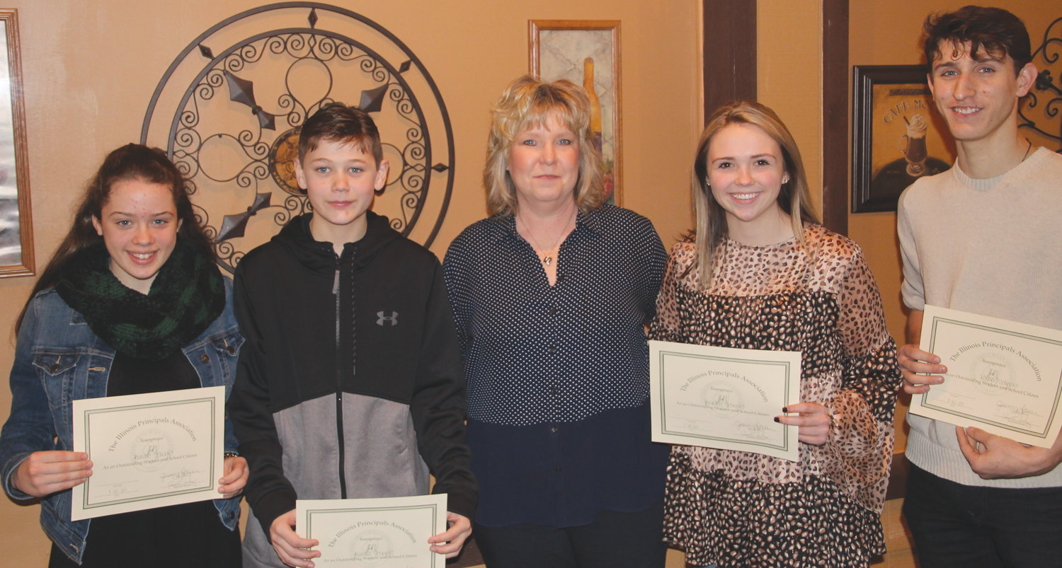 Kansas Principal Cindy Spencer introduced four students from the school district who were honored at the annual Edgar County Principal's Breakfast Jan. 10 at Tuscany Restaurant in Paris. Pictured, from left, are Katey Ehlers, Trevyn Cummins, Spencer, Natalee Gough and Camden Harmon.