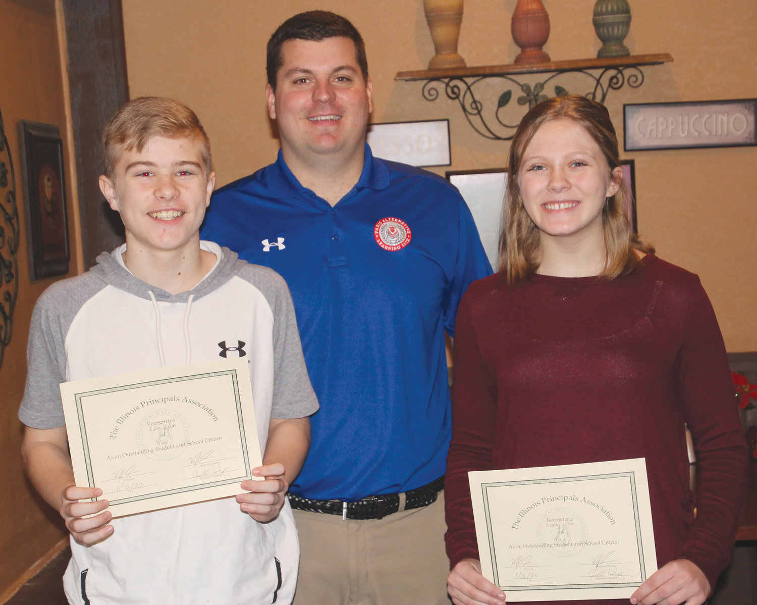 Two Mayo Middle School eighth graders were honored during the annual Edgar County Principal's Breakfast Friday, Jan. 10, at Tuscany Restaurant. Pictured, from left, are Kalvin Rigdon, Mayo principal Kyle Shay and Aubrey Wilson.