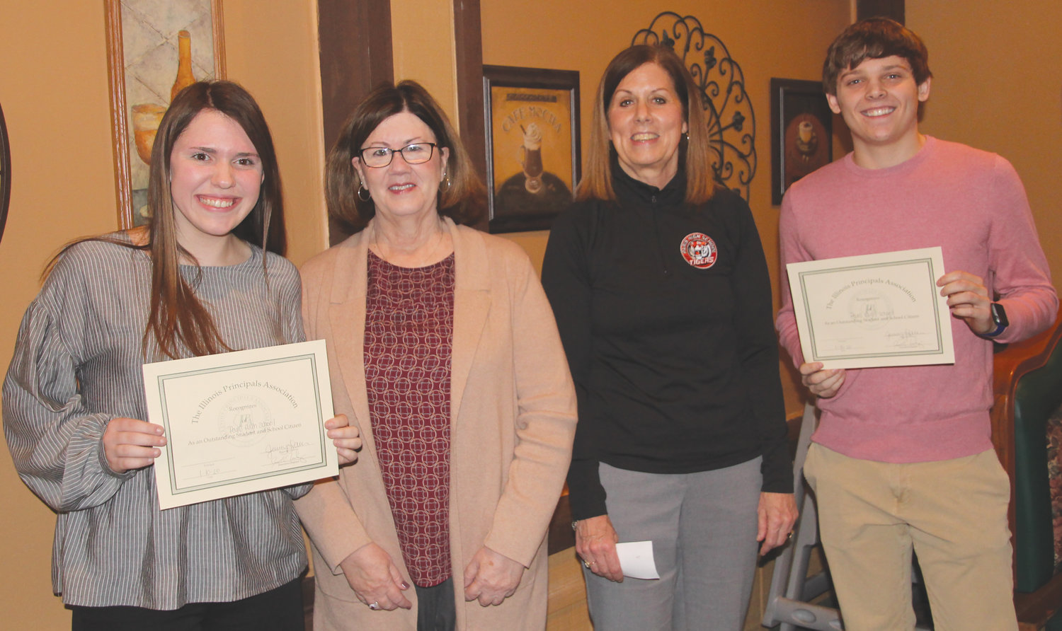 Interim Paris High School co-principals Lorraine Bailey and Carol Jones introduced two students from the school who were honored at the annual Edgar County Principal's Breakfast Jan. 10 at Tuscany Restaurant in Paris. Pictured, from left, are Katrina Strow, Bailey, Jones and Chase Hays.