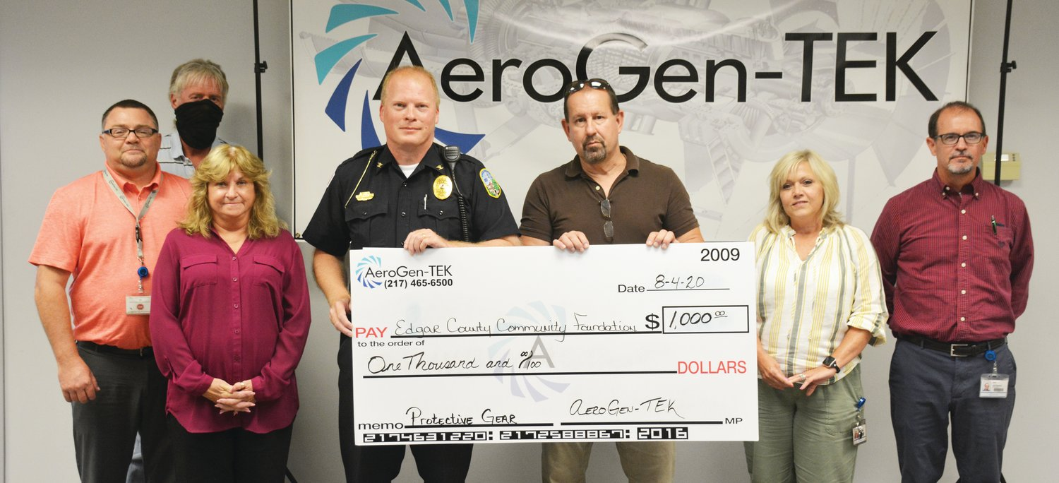 AeroGen-TEK donates $1,000 to the project seeking to buy improved body armor and helmets for every law enforcement officer in Edgar County. Left to right: Tim Hough, Bob Guiney, Michele Ellis, Paris Police Chief Eric Brown, Edgar County Sheriff Jeff Wood, Heidi Walls and Jay Rayhel.