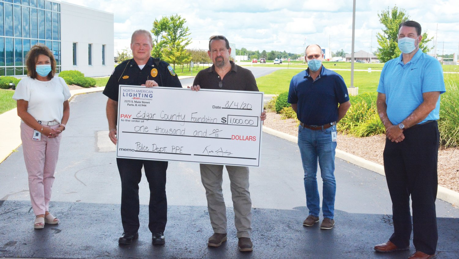 North American Lighting donates $1,000 to the project seeking to buy improved body armor and helmets for every law enforcement officer in Edgar County. Left to right, Sandy Webb, Paris Police Chief Eric Brown, Edgar County Sheriff Jeff Wood, Kirk Gadberry and Chad Thompson.