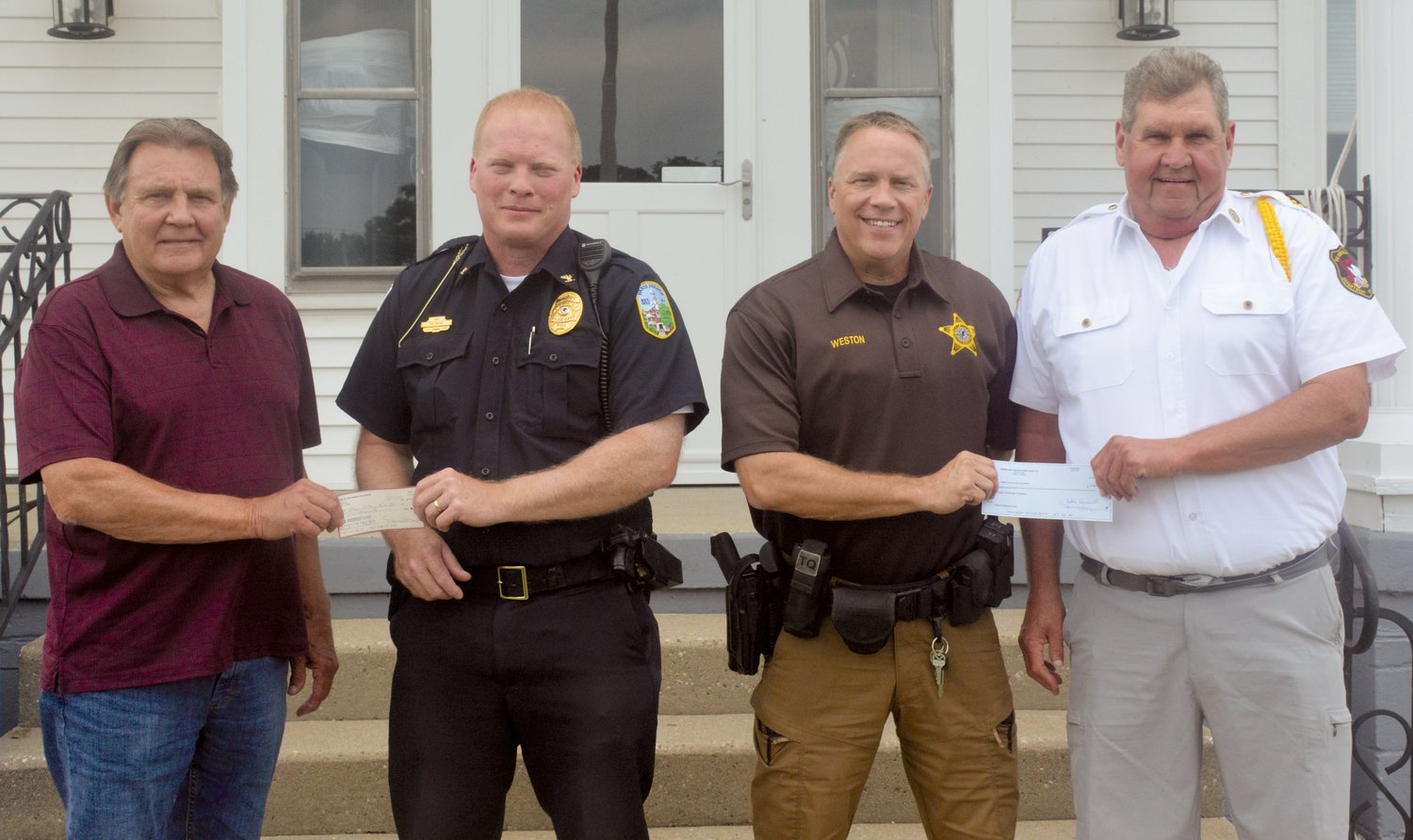 Representatives of the Paris American Legion Post 211 and the Paris Sons of the American Legion presented checks in support of the Friends of Edgar County Law Enforcement's fundraising effort to provide better equipment for all county officers. Pictured, from left, is Don Furry, Sons of the American Legion, Paris Police Chief Eric Brown, Edgar County Sheriff's Department Chief Deputy Derek Weston and Paris Post 211 Commander Paul Hanks.
