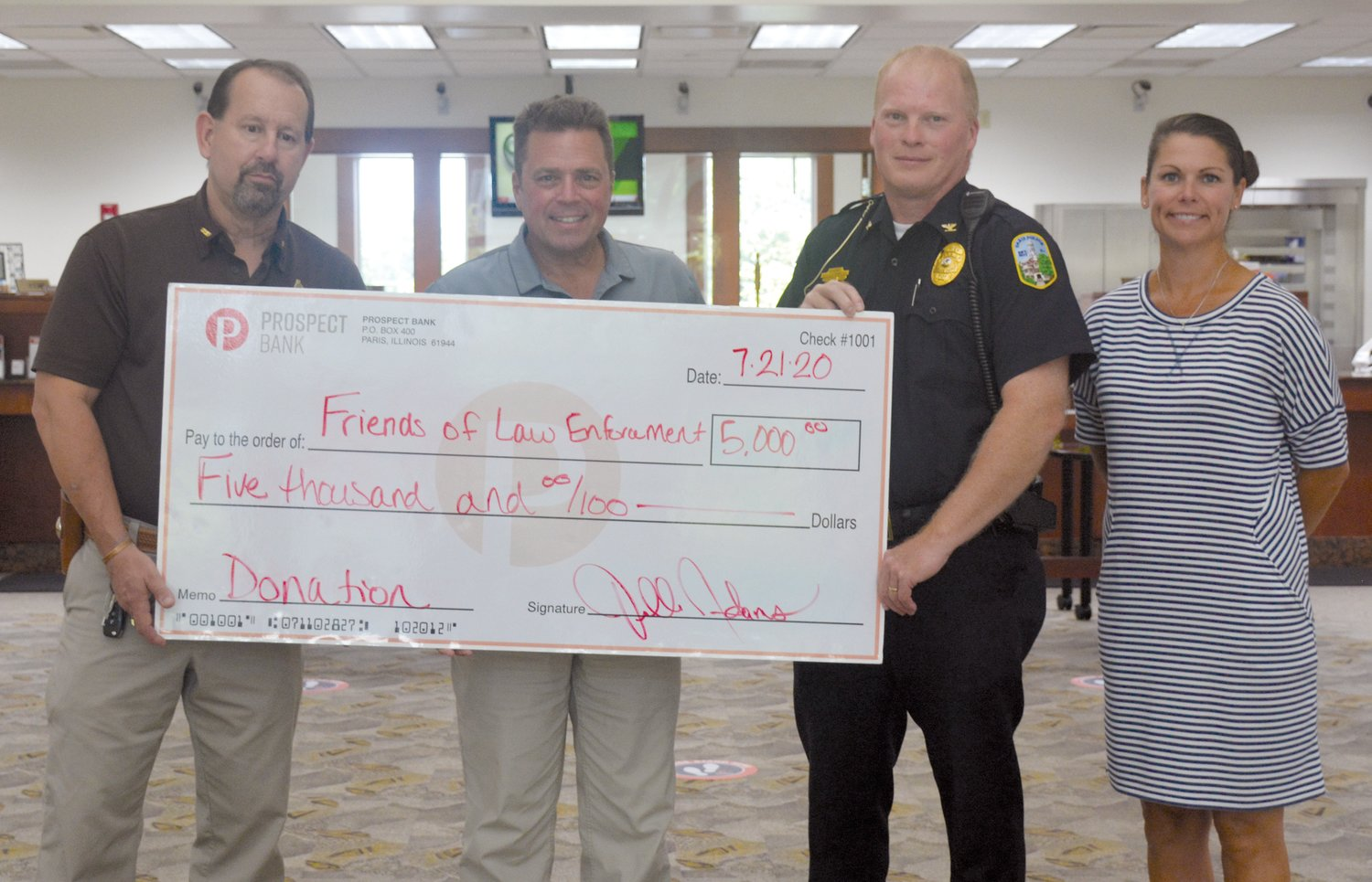 Prospect Bank of Paris presented a $5,000 check to Friends of Edgar County Law Enforcement in support of providing better equipment for all county and city officers. Pictured from left are Sheriff Jeff Wood, Eric Volkmann, president and CEO of Prospect Bank, Paris Police Chief Eric Brown and Prospect executive vice-president Jenelle Adams.