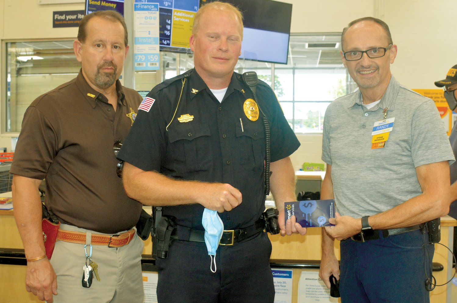 The Paris Wal-Mart presented a check to support the fundraising effort of the Friends of Edgar County Law Enforcement to provide better equipment for all county and city officers. Pictured, from left, are Edgar County Sheriff Jeff Wood, Paris Police Chief Eric Brown, and Paris Wal-Mart manager Randy.