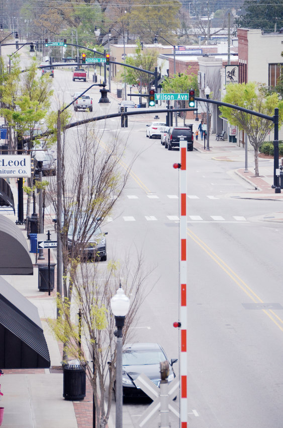 Light traffic is seen on Broad Street Tuesday, a day after the governor asked more businesses to close to arrest the spread of COVID-19.