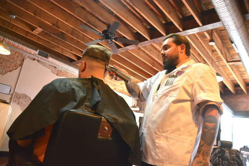 Corban Ehmke at Bearded Goose cuts hair for the first time in two months on Tuesday.
