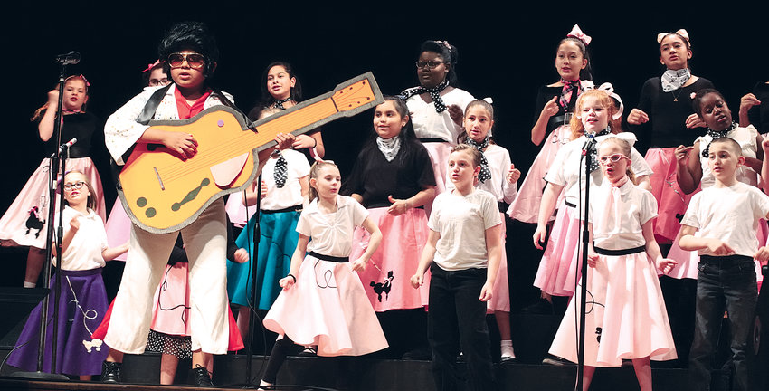During the show Thursday, the sixth act was performed by Angier Elementary School. Director Ashley Musgrave led them as the group sang Elvis Presley's 'Blue Suede Shoes' as they danced in their '50s attire. The star of the performance was Michael Mancera-Quiroz who dressed as Elvis. More photos from this year's event will be published this week.