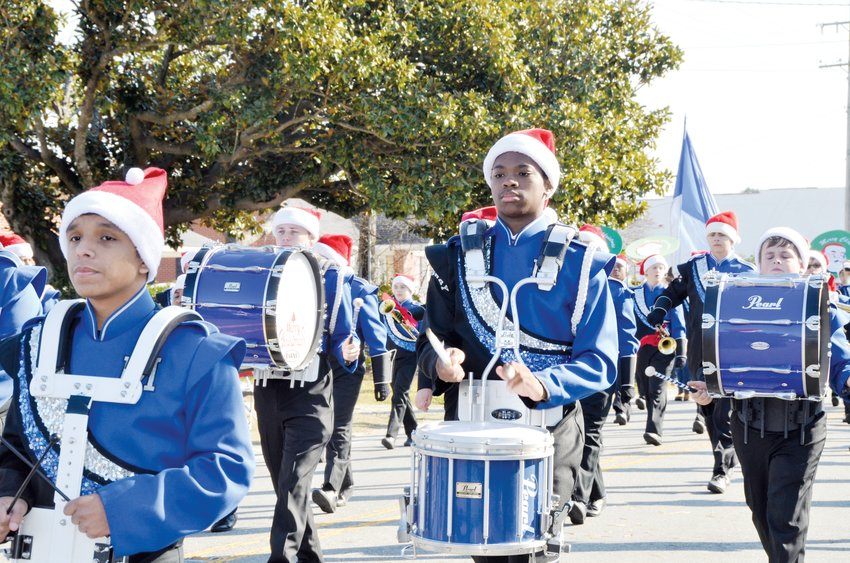 The Midway High School Marching Band performs Saturday during Newton Grove's annual Christmas Parade. Pictured from left are Bryant Caldera, Cameron King, Brandon Cousar and Hunter Warren.