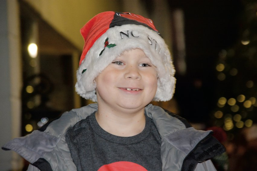 Carter Williams, 7, was in the holiday spirit Friday night at the Benson annual Christmas parade.