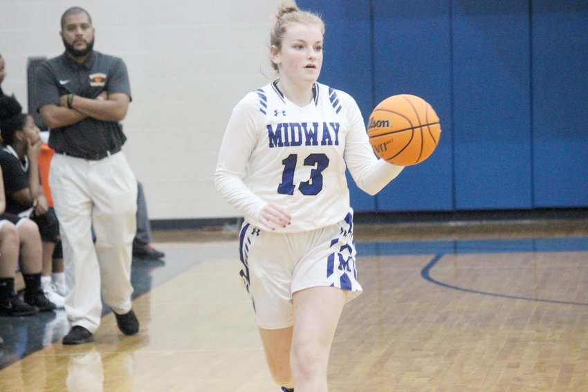 Allison Belfowers pushes the ball up the court in Midway's 58-13 win over Hobbton on Thursday. Belfowers had 7 points in that game and a team-high 12 in Friday's victory at Lakewood.