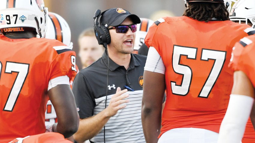 Campbell football defensive coordinator Weston Glaser gives instruction to players. Glaser's leadership has helped the Camels put together the Big South's best pass defense over the last two seasons.