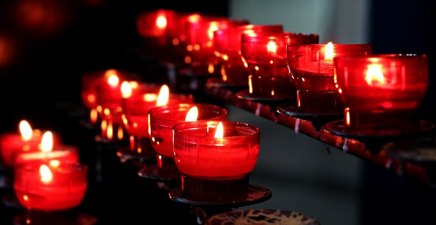 Candles are lit inside a church.