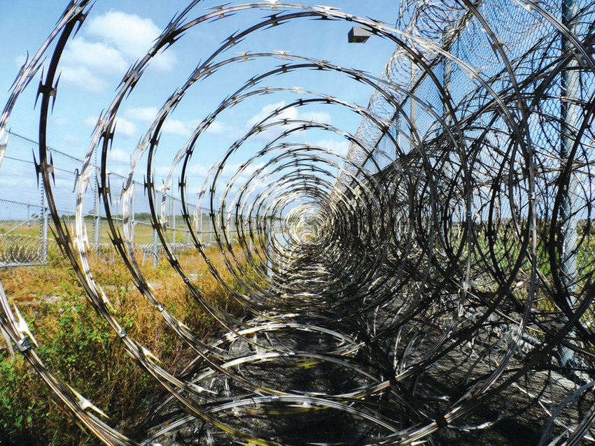 A prison fence is pictured.