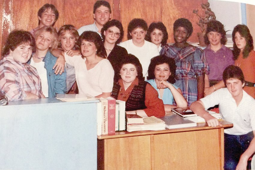 Members of the 1985 annual and newspaper staff at Coats High School pose for a picture. Annual staff members were: Editor Brookie Betts, Copy Editor Melinda Stanley, Sports Editors Denise Williams and Gary Meadows, Activities Editor Phyllis Gagliardo, Faces Editors Jimmy West and Kitty Betts, Academic Editors Kim Jackson and Alice Ann Roberts, Advertising — Mark Landon and Index — Kitty Betts and Pam Denton. Newspaper staff members were Editor Pam Denton, Makeup Editors Lori Moore and Donna Allen, Sports — Denise Williams and Gary Meadows, Art Editor Jayson Ennis, Editorials — Pam Campbell and Sheryl Harvey, Exchange Editor Pam Campbell and Feature Editor Lori Moore. Literary Magazine editor was Alice Ann Roberts and illustrator was Jimmie West. Mark Langdon was business manager for both staffs, Lori Moore was copyreader and Melinda Stanley and Phyllis Gagliardo were typists.