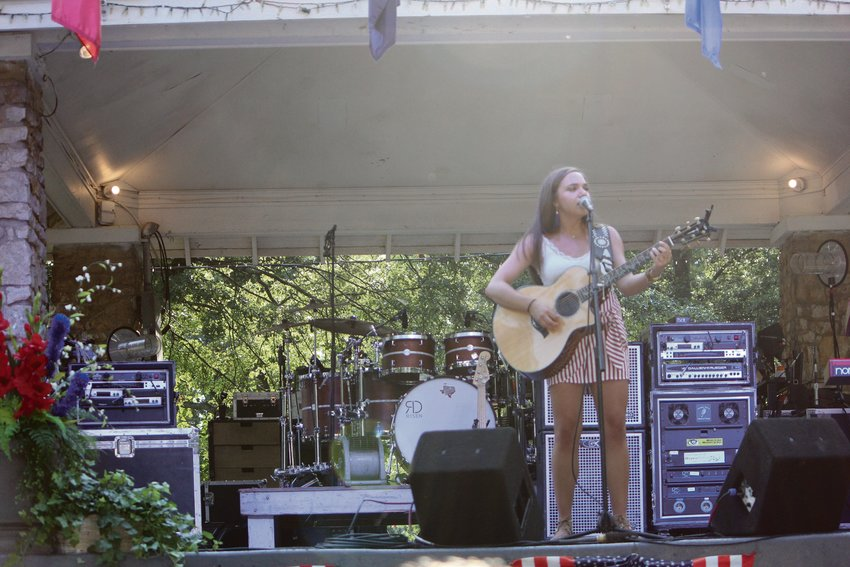 Angier singer/songwriter Paige King Johnson performs on stage. She is hosting a live concert in a Country Yard Party on Aug. 29 in Angier.