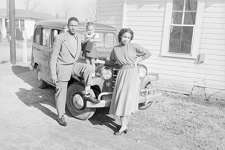 The North Carolina Museum of History will present the program 'The Legacy of the Green Book,' Thursday, Oct. 15, at 7 p.m. via Zoom. This outdoor photo of a mother, father and child standing by a car was taken by the Rev. Henry Clay Anderson in 1940. © NMAAHC.