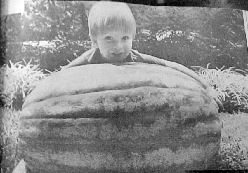 Who knew when Josh Parrish hugged this hefty watermelon that he and his two brothers would progress to be Eagle Scouts?