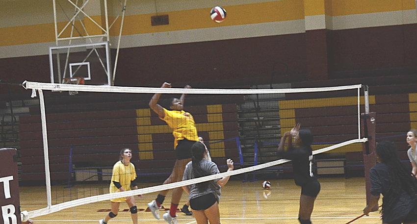 Harnett Central middle hitter Syniah McMiller goes up for a spike during a preseason practice. Central is scheduled to open the season Nov. 16.