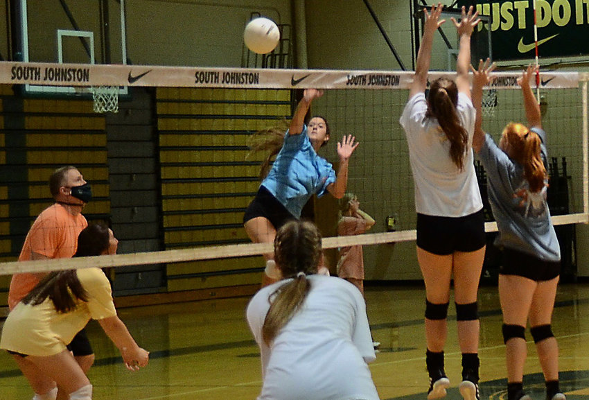 South Johnston's Katon Blackmon, center, hits a ball over the net during a recent preseason practice. Blackmon enters the season as All-Record Volleyball Player of the Year.