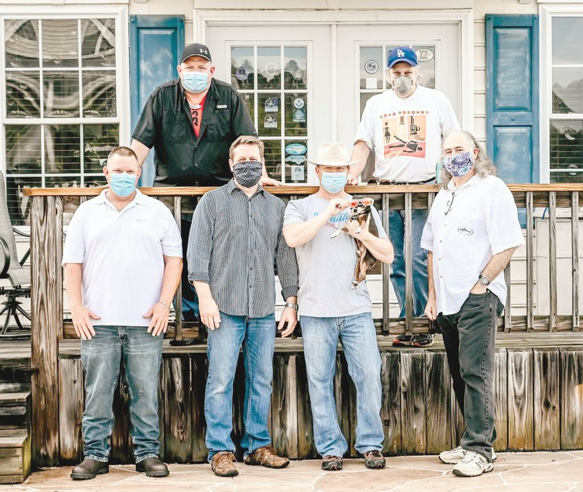 Local band Identity Crisis will offer up some music Saturday at 4 p.m. during a concert at Erwin's Outdoor Christmas Market. Band members pictured are, from left, in front, Seneca Dale, Jon Matthews, Tim Morris holding Nacho and Joe Wise; in back, Michael Wood and Phil Abrusato. The band Carolina Rattler will open up at 2 p.m.