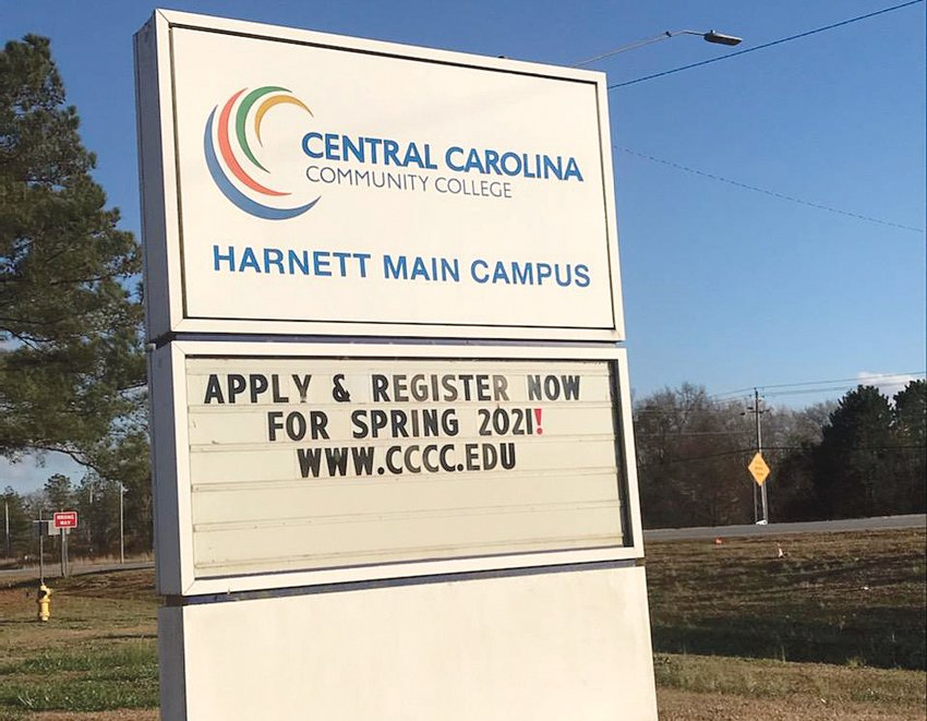 A sign outside Central Carolina Community College's Harnett campus says registration is open for the spring semester.