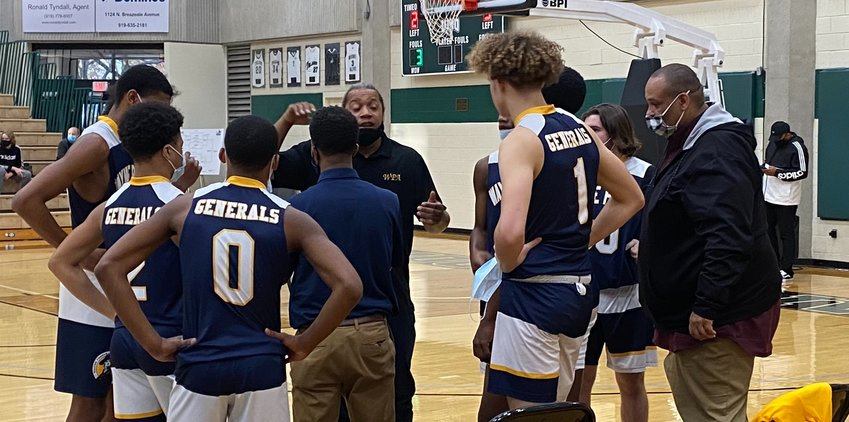 Wayne Prepatory Academy coach Anthony Wright talks with his team during a timeout against Community Christian in the Southern Bank/Mount Olive Pickle FCA Winter Classic on Monday afternoon.
