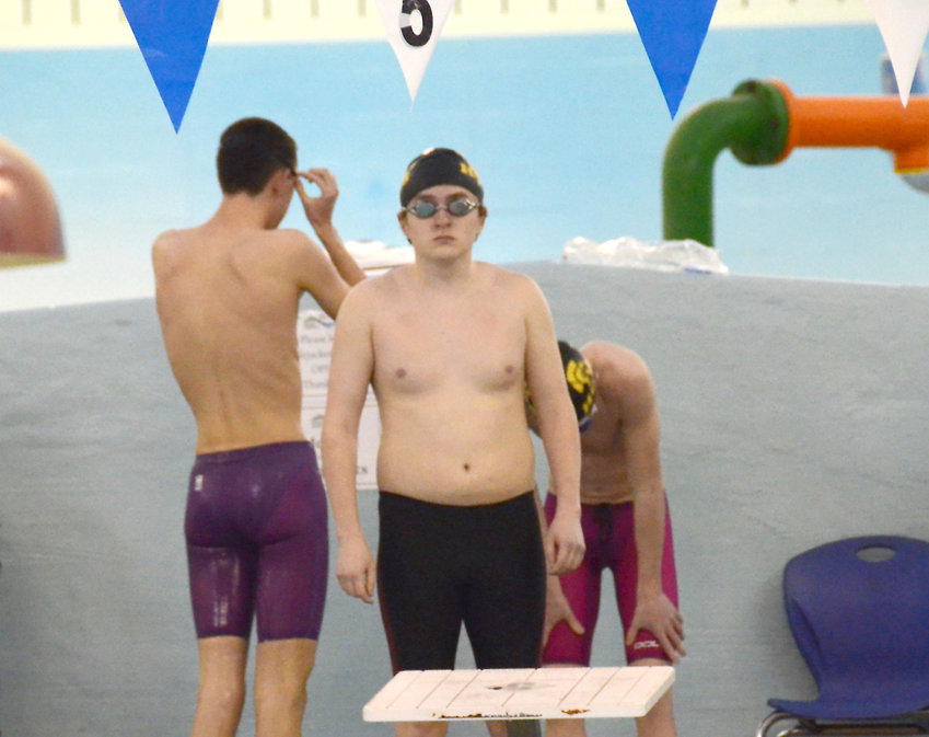 Logan Marquez, center, and the Harnett Central swim team competed in its only meet of the year on Jan. 25 at the Smithfield Recreation and Aquatic Center.