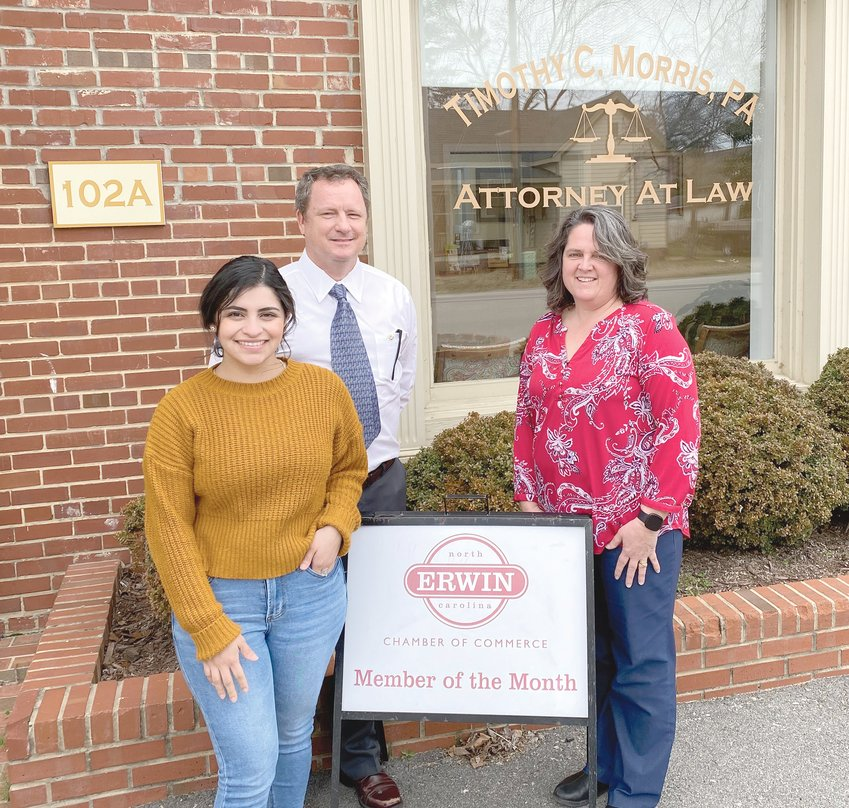 The law offices of attorney Timothy C. 'Tim' Morris, located at 102-A S. 12th St., Erwin, has been recognized as the Erwin Chamber of Commerce's member of the month. Morris, center, has been in private practice since 1998. He handles various types of cases from traffic tickets to vehicle wrecks. He is pictured here with his staff, secretary Maria Paredes, left, and paralegal Karen Lamm. Lamm has been working for Morris close to 20 years and Paredes for four years. Morris said he loves his hometown of Erwin. 'I have two of the best employees an attorney could have,' he said. 'Any success I have ever had is properly attributed to them.'