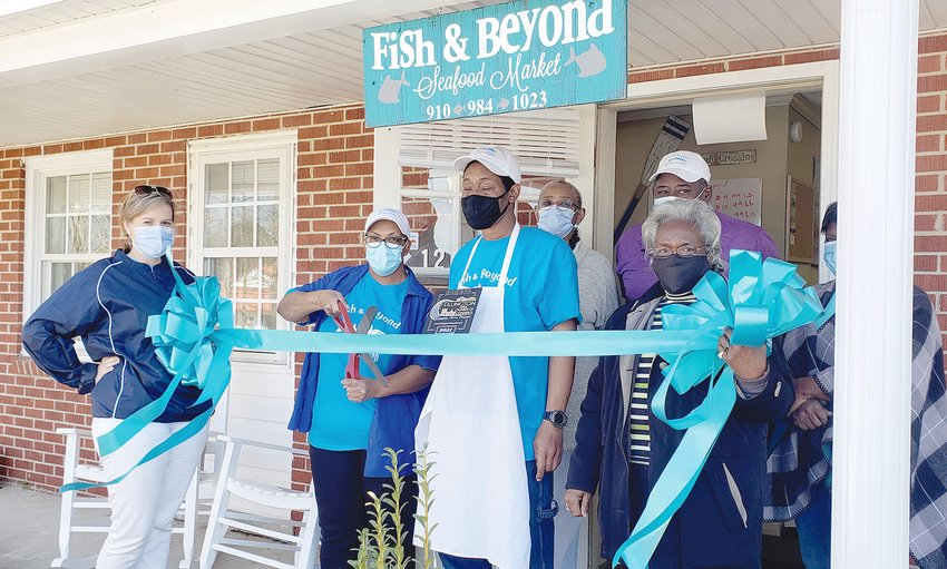 Fish and Beyond cuts ribbon in Lillington.The Lillington Area Chamber of Commerce held a ribbon-cutting ceremony March 3 for Fish and Beyond, located at 1234 N. Main St., Lillington. The business is the only fresh fish market in Lillington. Pictured from left are Lillington Chamber PresidentAnn Milton, owner of Fish and Beyond Nancy Clark, Gerald Purdie, Dianne Barbee, John Clark, Clara McNeill and Rose Massey.