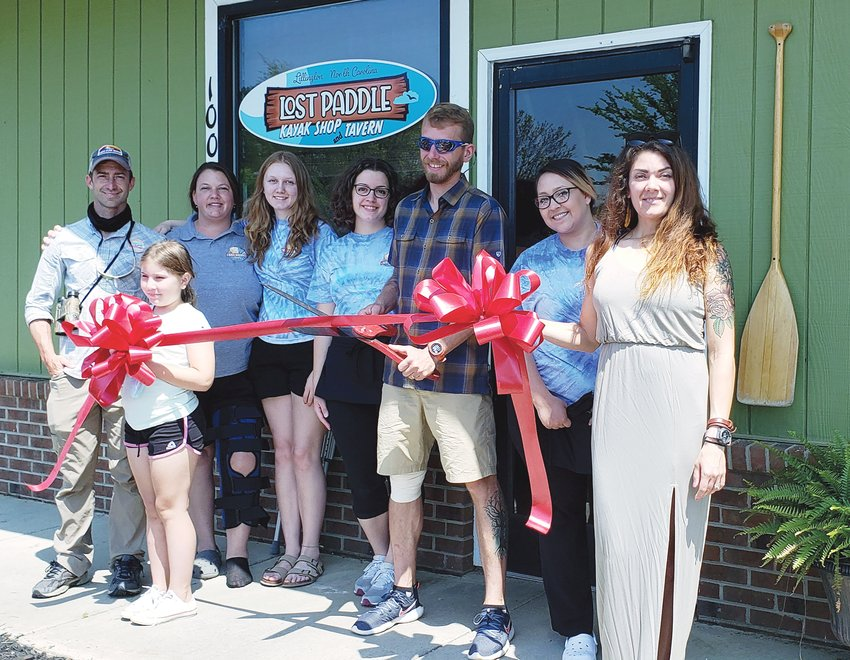 Ribbon cut for Lost Paddle Tavern.The Lillington Area Chamber of Commerce hosted a ribbon-cutting ceremony April 14 for Lost Paddle Tavern located at 100 S. Main St., on the Cape Fear River in Lillington. Pictured from left are Andrew Simpson, Melissa Smith, Mia Smith, Lily Spicer, owner Ilia Smirnov, Kriss Garcia and Megan Smirnov. The restaurant offers several dining options, including a dining room, enclosed patio, outdoor riverfront patio, curbside pickup and drive-up window.
