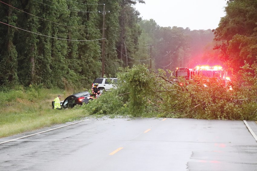A tree fell across U.S. Highway 301 just north of the town of Wade during a severe storm Tuesday night. Two vehicles traveling south collided with the tree and ended in a ditch on the side of the road. One person was transported to Cape Fear Valley Hospital with injuries. The N.C. State Highway Patrol investigated the wreck.