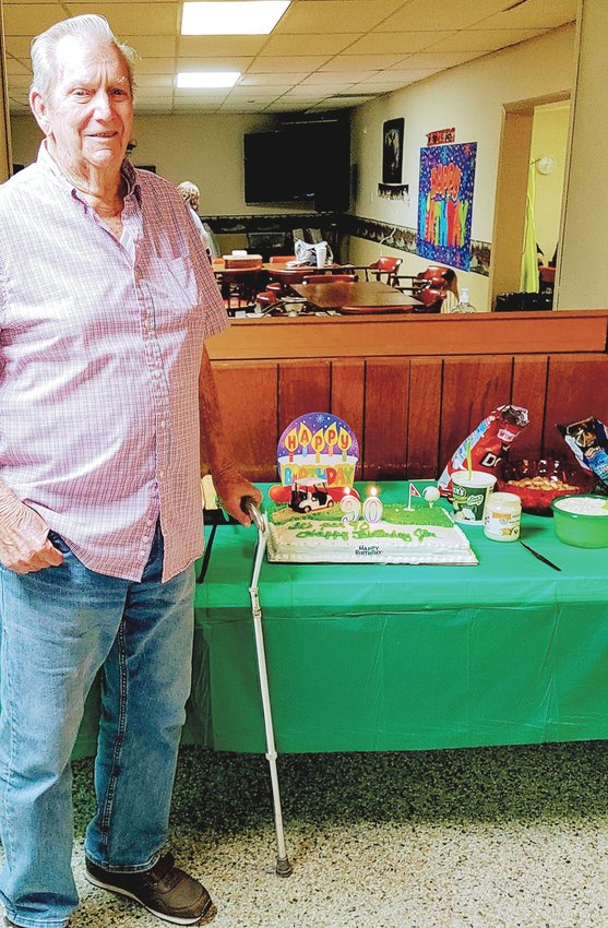 Jim Harper celebrates his 90th birthday at a surprise celebration. Friends and family gathered at the Dunn Moose Lodge to honor Harper sharing good wishes and food.
