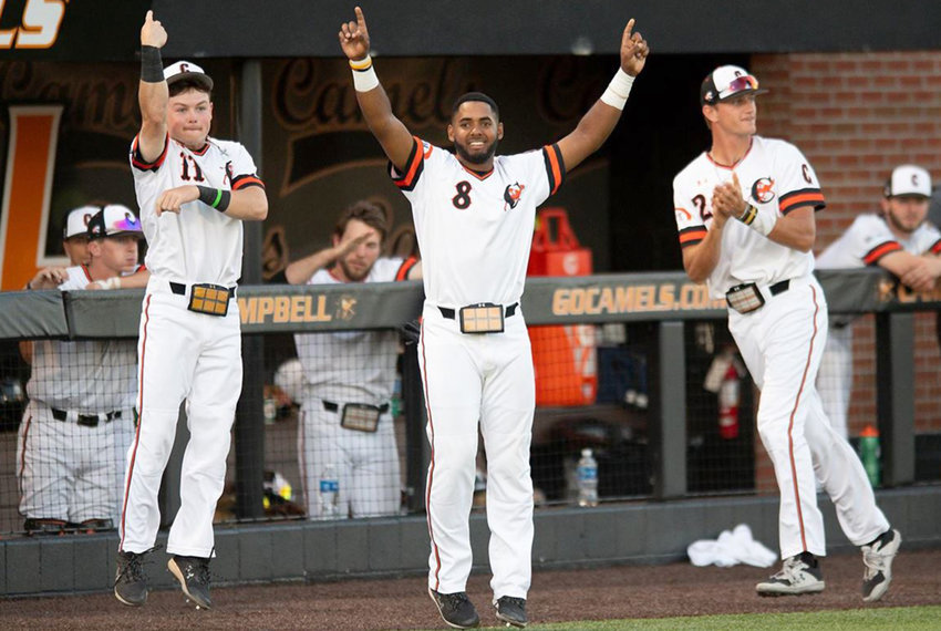 From left, Campbell's Bryce Arnold, Waldy Arias and C.J. Peechatka celebrate during a regular-season game. The third-seeded Camels play No. 2 VCU Friday as part of the Starkville Regional in this year's NCAA baseball tournament.