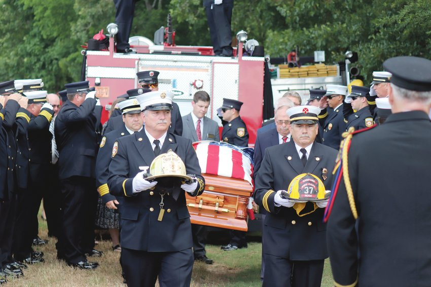 Firefighters carry the coffin of James 'Jamie' Melvin Rose during a funeral service on Friday, June 11. Rose served the fire service for 35 years and as chief of the Buies Creek Fire Department. He left behind a score of family and friends after a two year battle with esophageal cancer came to an end on June 6. Rose was laid to rest in Rose Family Cemetery in Lillington.