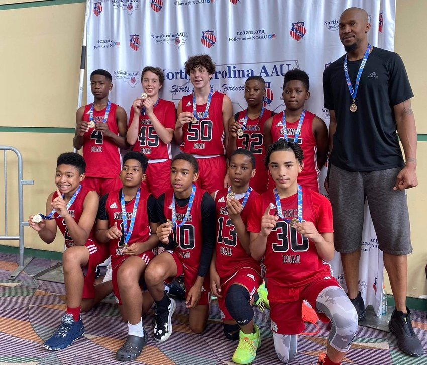 Dunn Middle School student-athletes Malachi Cooke, third from right on the back row, and Kobe Plata, far right on the front row, wear first-place medals during N.C. AAU State Championships in Greensboro last Saturday.